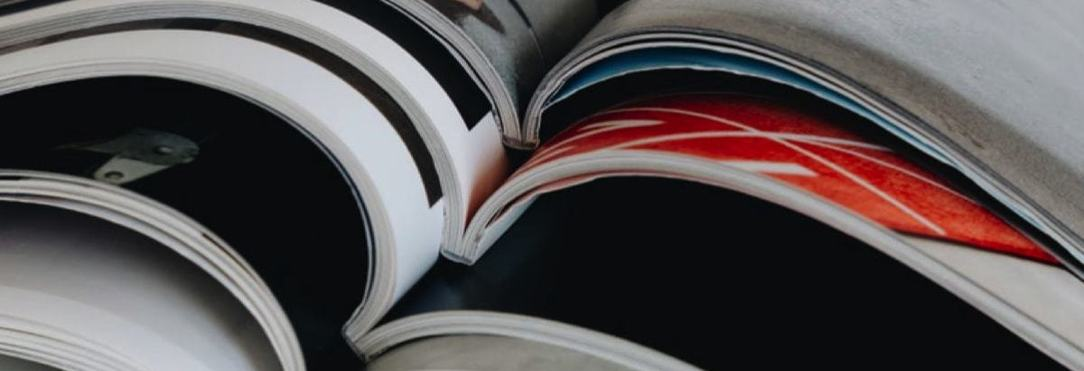 a stack a printed magazines