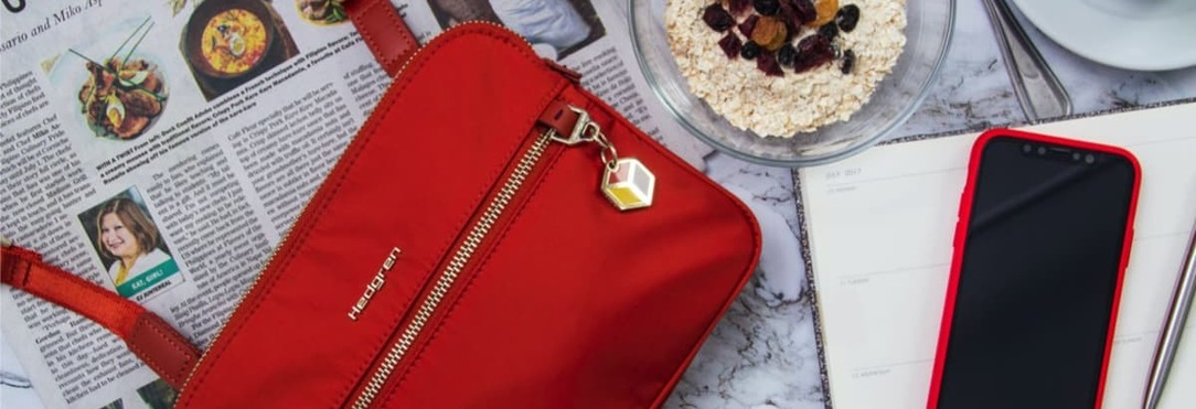 magazine, red handbag and smartphone in red case