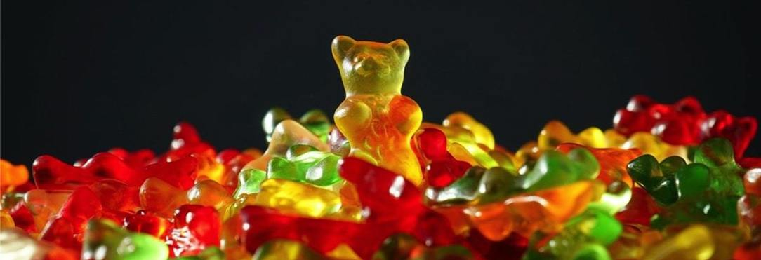 multi-coloured sweets with a teddybear shape standing out